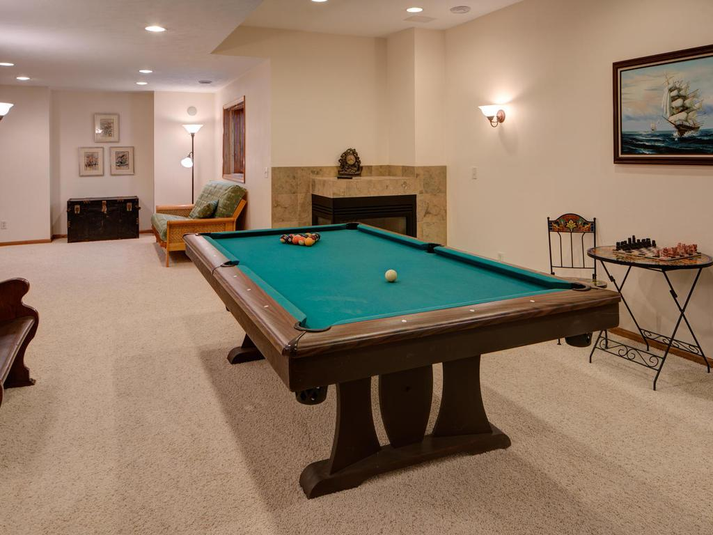 Lower level fireplace makes amusement room and second family room a fun, cozy place to hang-out.