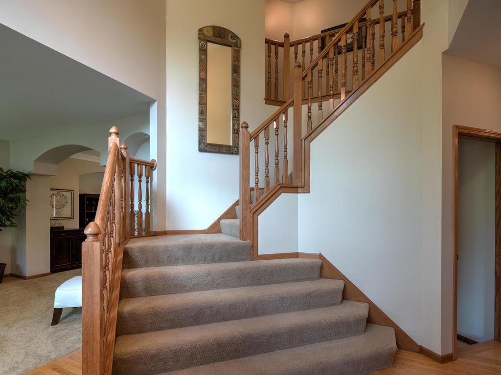 Two-story, dramatic foyer greets you as you enter the home.