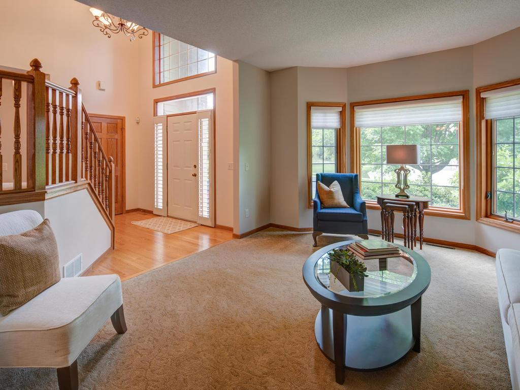 Windows abound with light streaming into your main floor living room.