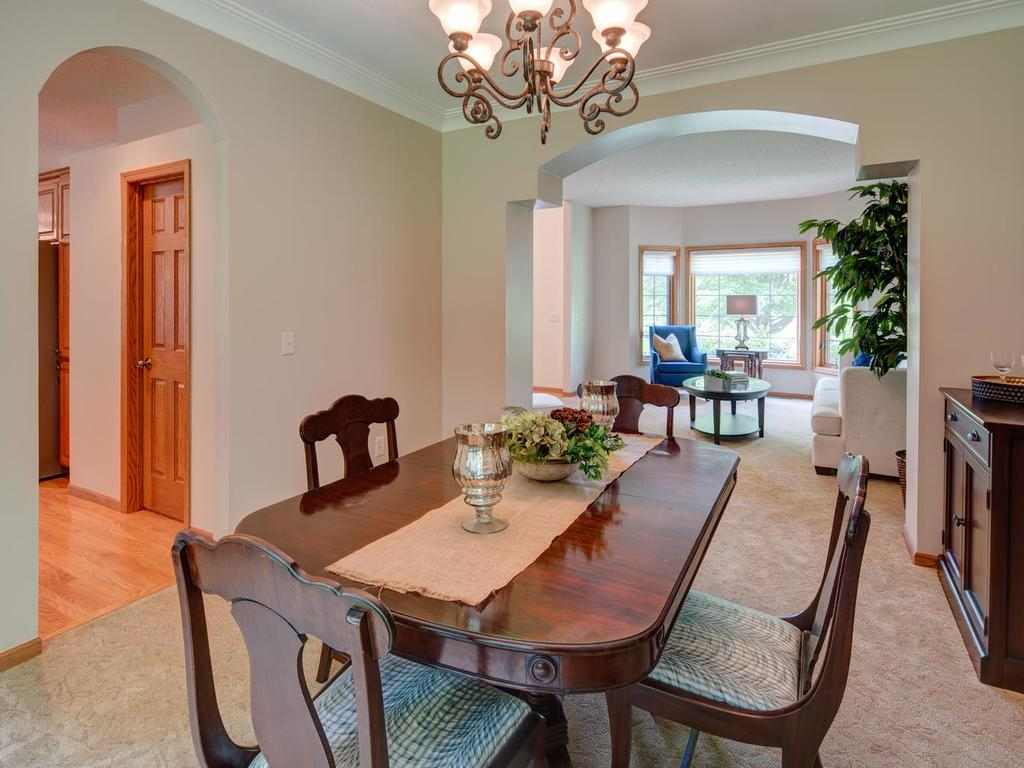 Charming dining room accesses large kitchen and living room.