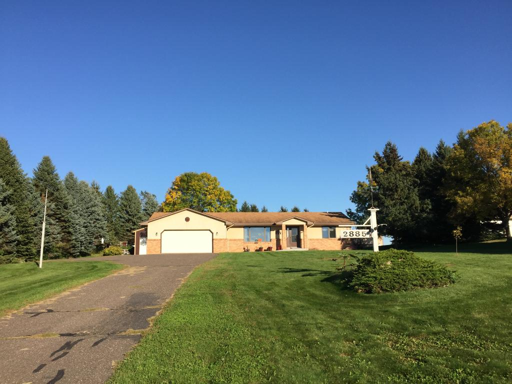 One level living with 2+ acres of privacy and outdoor living!