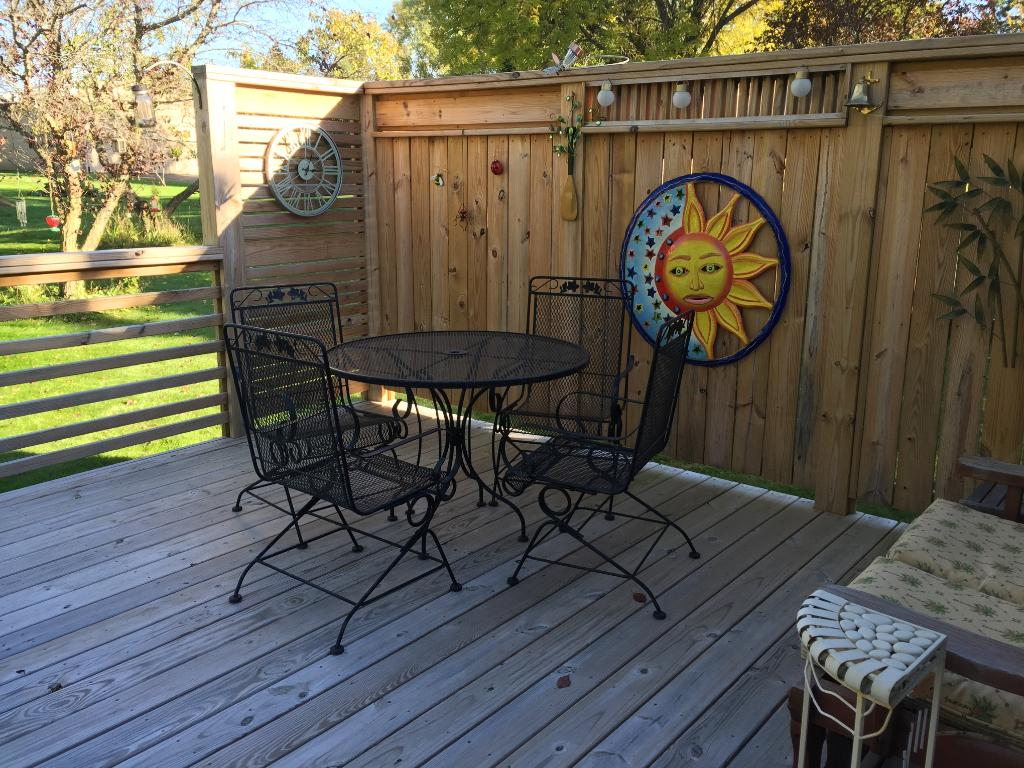 New privacy deck off of three season porch overlooking back yard.