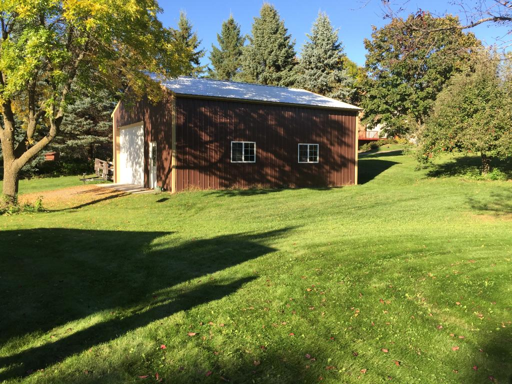 30 x 34 outbuilding with 10 foot door, 12 foot ceilings and concrete floor.