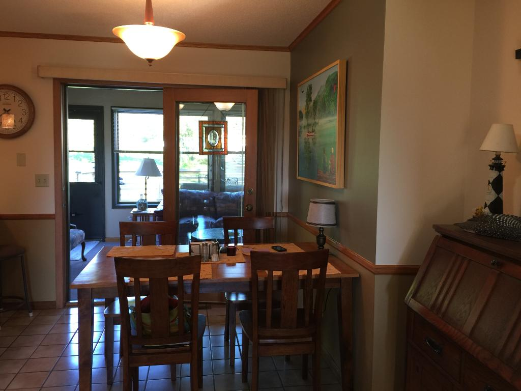 Open floor plan and spacious dining area with patio doors open to the three season porch.