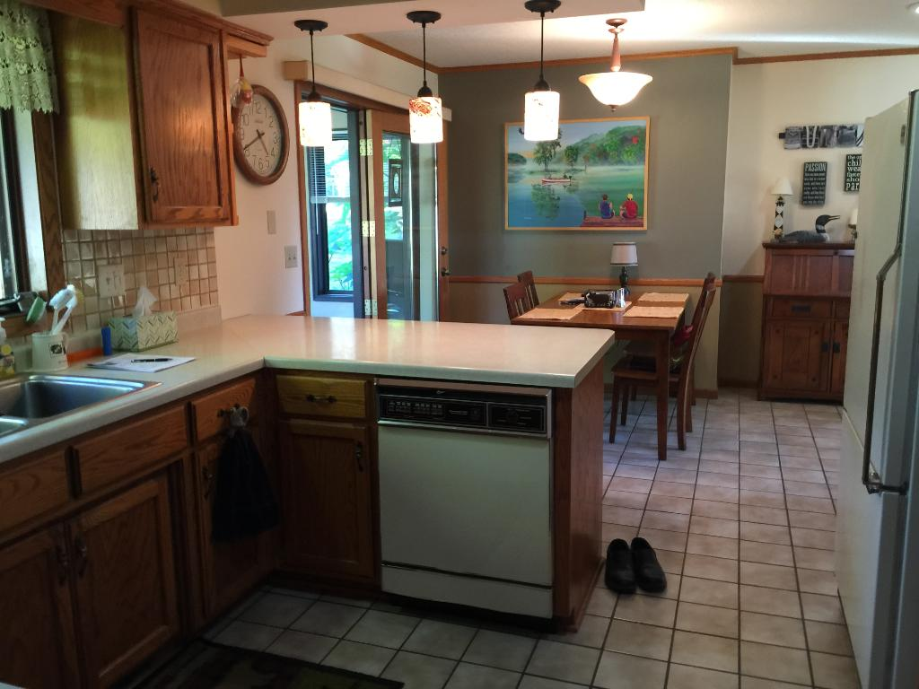 Kitchen has custom built cabinets, a large walk in pantry and a breakfast bar.