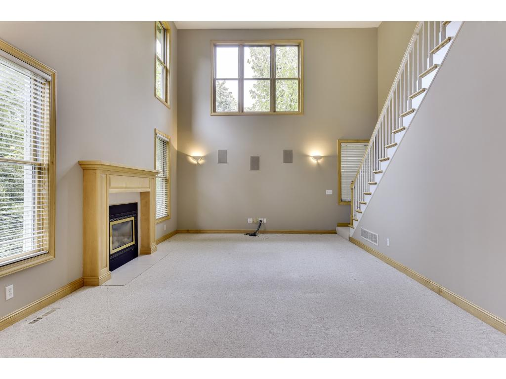 Vaulted ceilings make this already large living room seem even bigger!