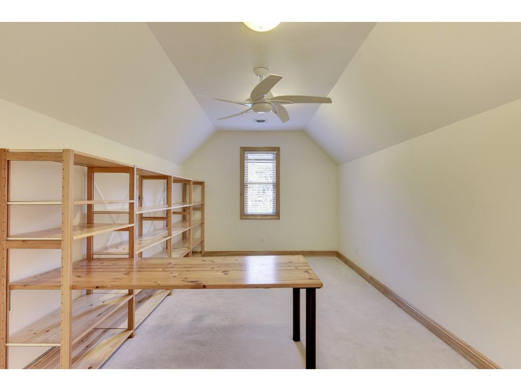 Enormous owner's suite closet can also be used as a sewing room or craft room.