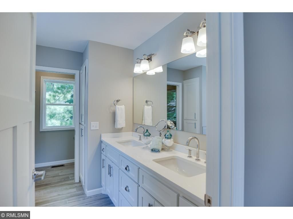 Master dual sink vanity with separated shower and tub
