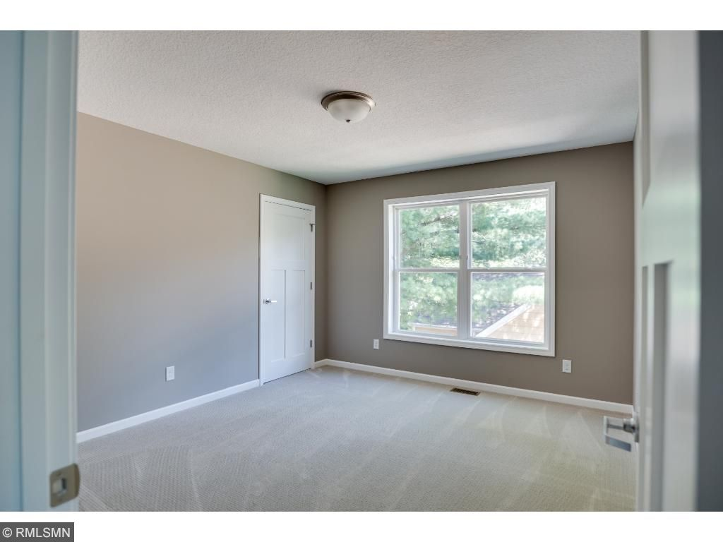 Upper middle bedroom with walk-in closet
