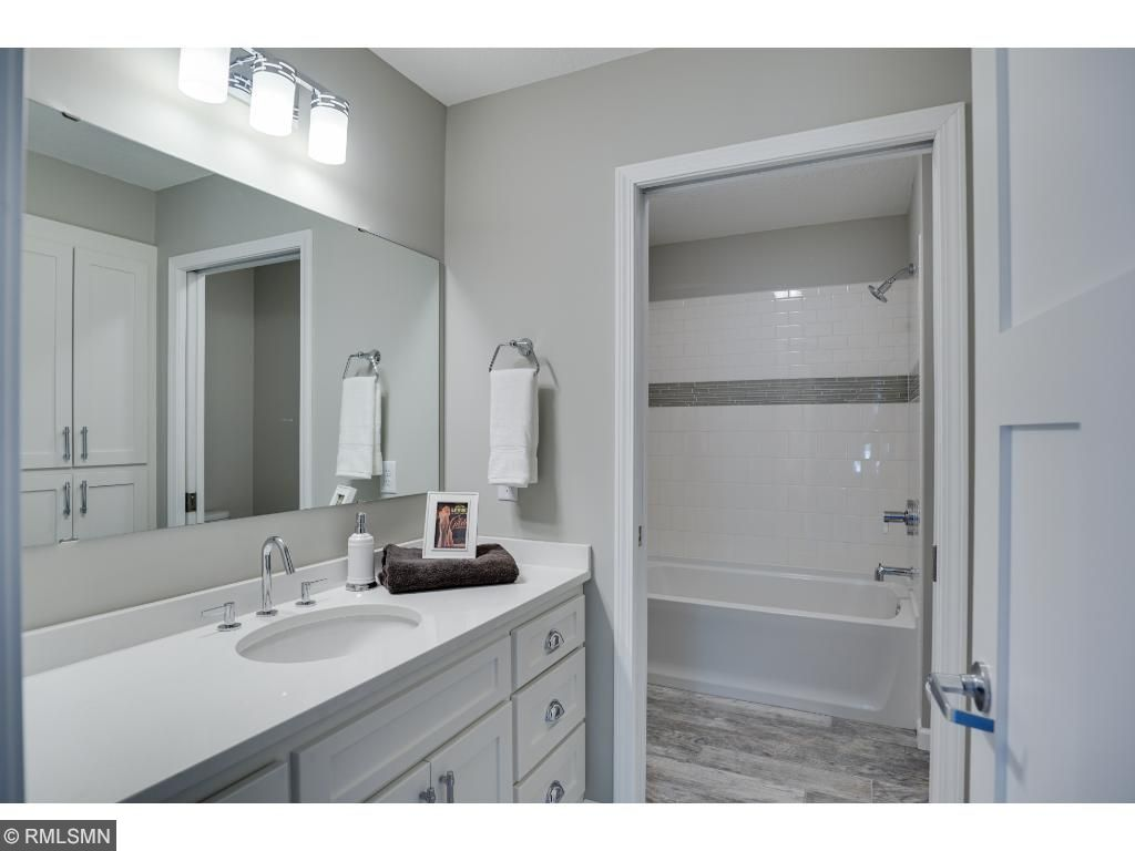 Upper hall bath with separated tub area from vanity area