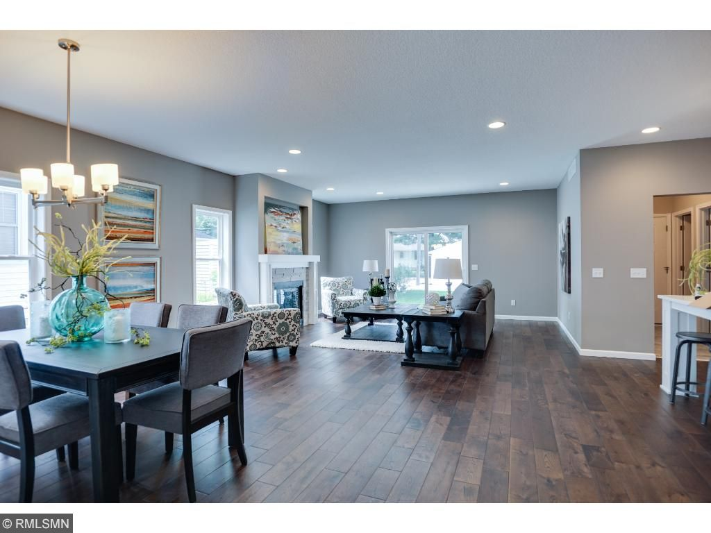 Open main floors with 9' ceilings and solid oak floors throughout main, and lots of natural light
