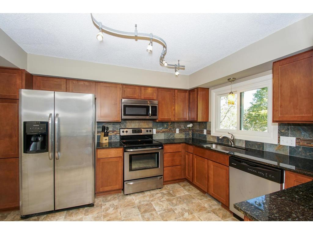 Take note of the stainless steel appliances, and custom backsplash.