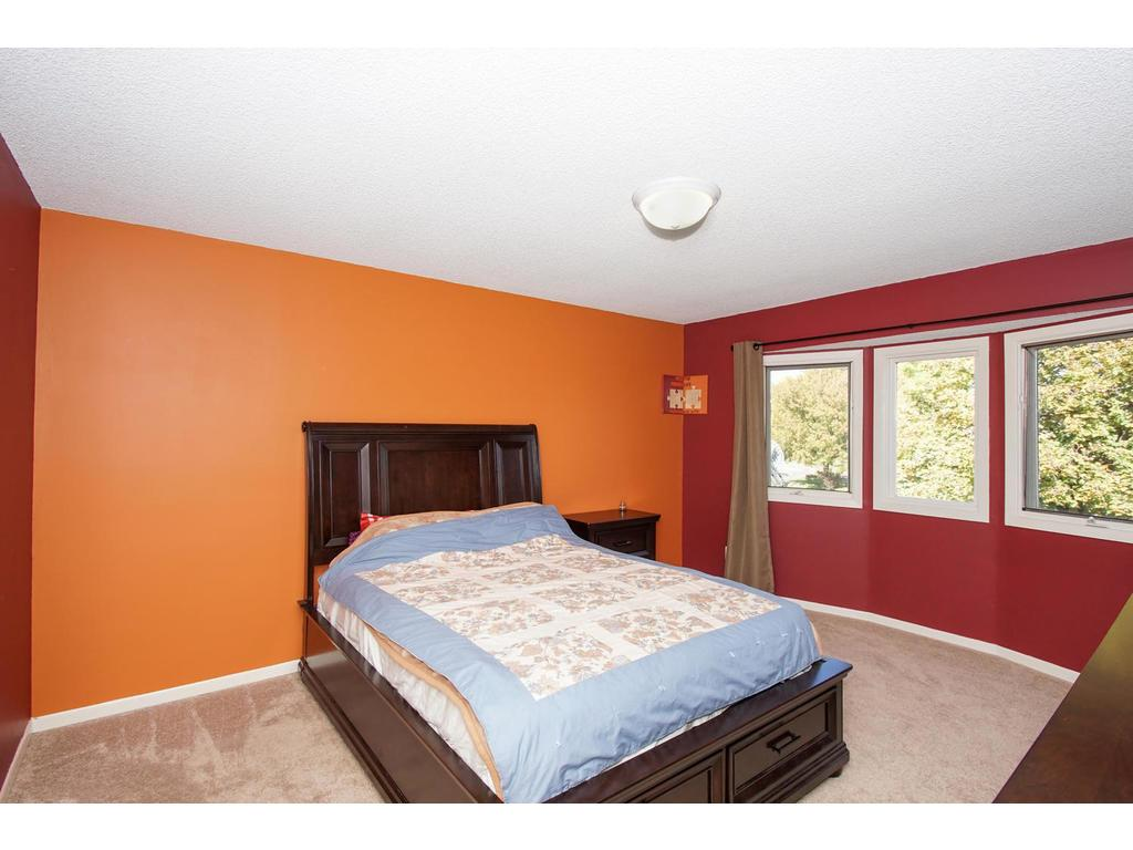 Your spacious master bedroom overlooks the front yard, and tree lined street.