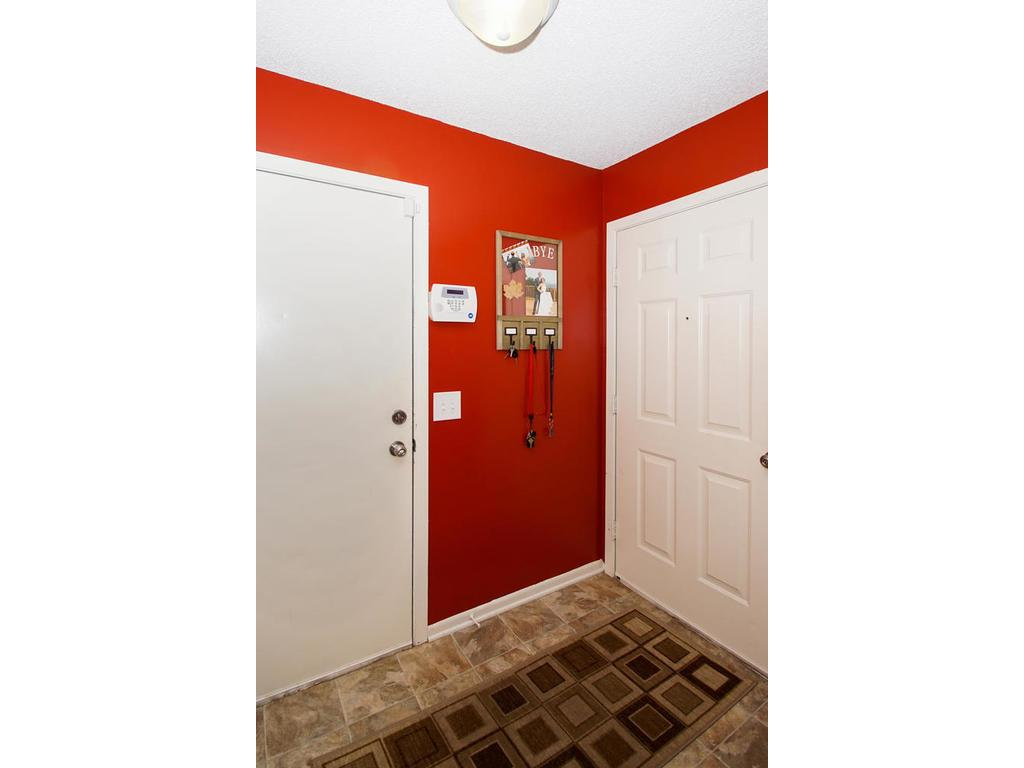 The front entryway provides access to both the front door, and your two-car attached garage.