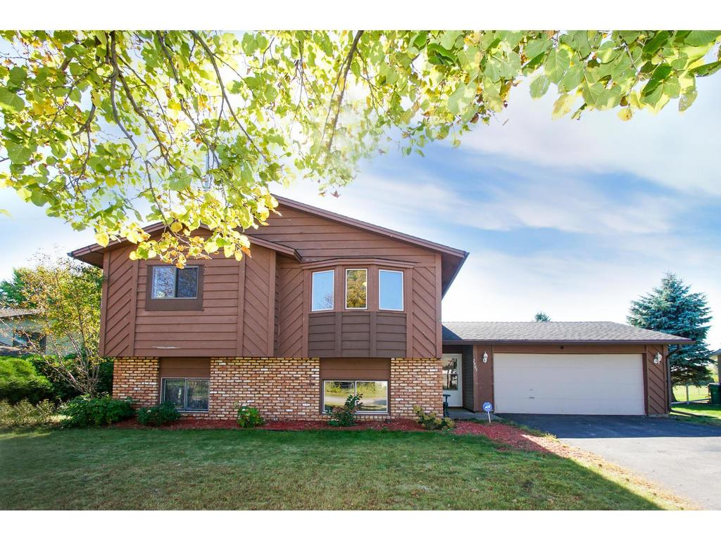 Two-car attached garage, landscaped yard, and note the already installed security system for your peace of mind.