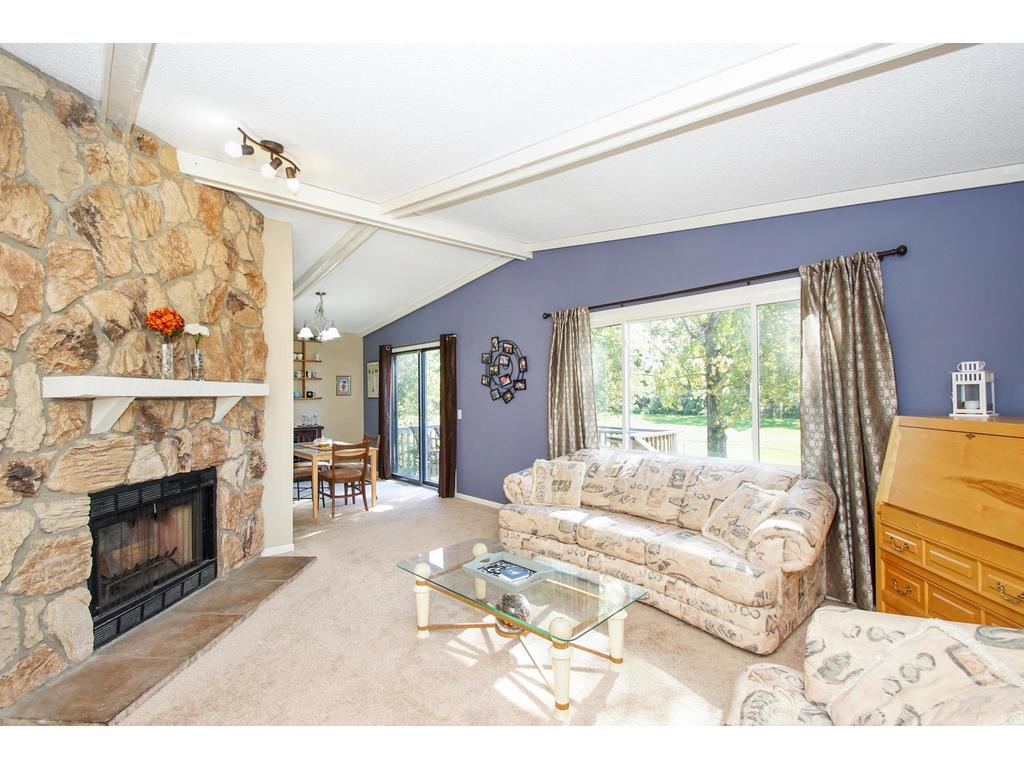 Your living room offers vaulted ceilings and a wood burning fireplace.