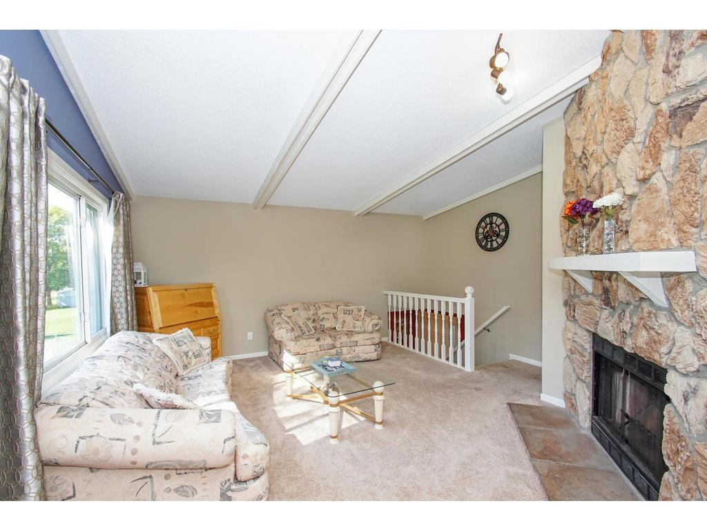 Imagine sipping cocoa or hot cider in front of this beautiful natural stone fireplace.