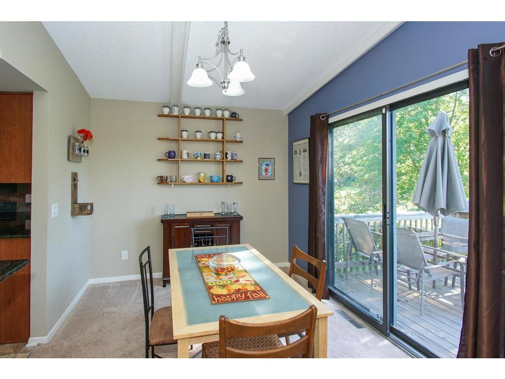 Step onto your deck directly from the dining room. This convenient layout is perfect entertaining, and summer cookouts.