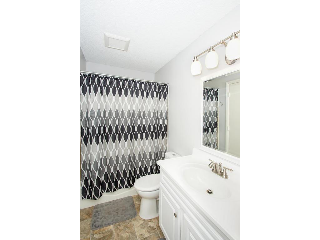 Tile flooring nicely accents this brightly lit and spacious full bath.