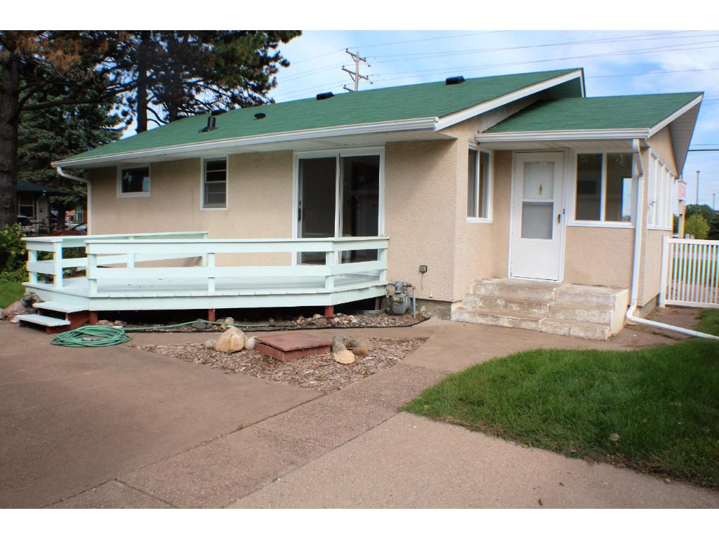 spacious fenced back yard, large patio area and deck.
