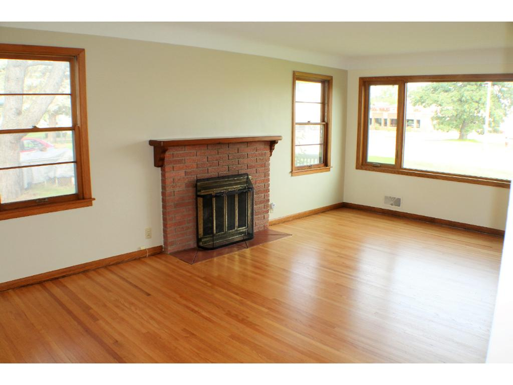 Newly refinished hardwood on main floor, lots of windows bring in natural light. Love all the storage closets here.