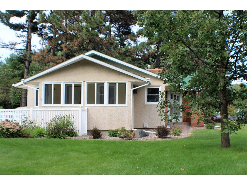 Large corner lot, side view, this is a beauty! All new ROOF on house and garage 2015.