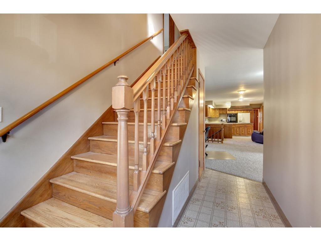 Gleaming hardwood staircase to upper level