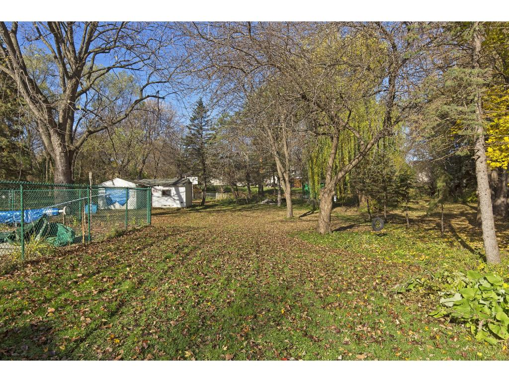 Beautiful 1/2 acre lot offers huge play space