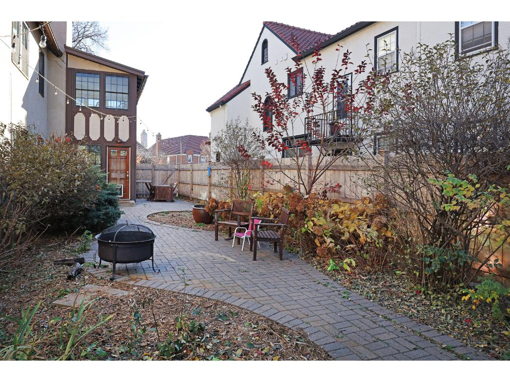Paver patio throughout backyard with established perennial gardens.
