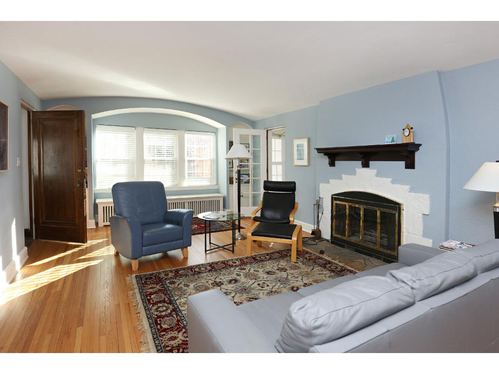 1st floor living room-window bench in archway mirrors barrel vaulted ceilings in living rooms