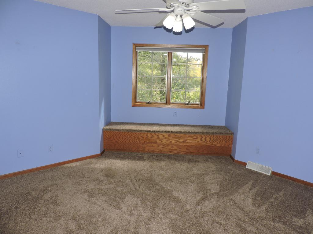 2nd floor bedroom w/window seating and storage