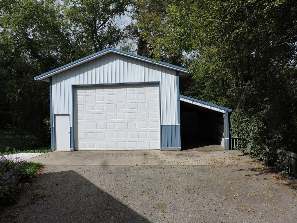 Additional pole shed style garage and lean-to.