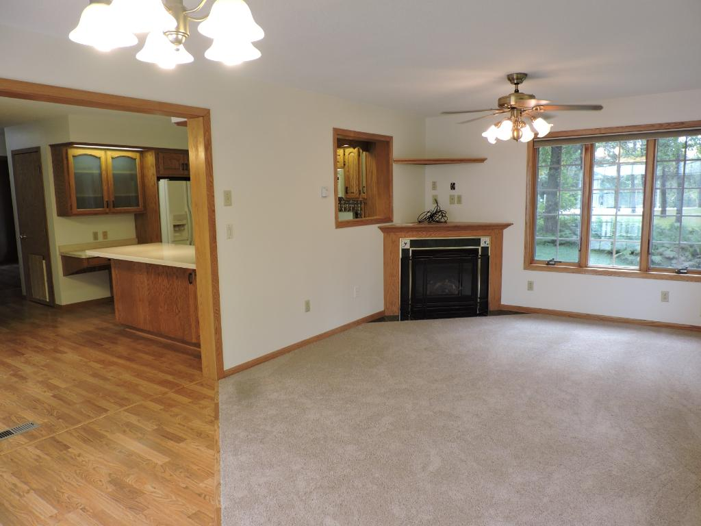 Main floor family room w/gas fireplace and side view of kitchen.