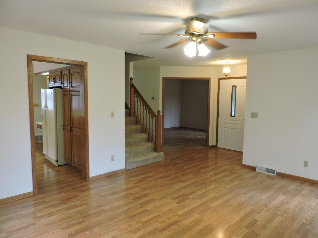 Looking from living room toward front entry, office and stairs leading to the 2nd floor.