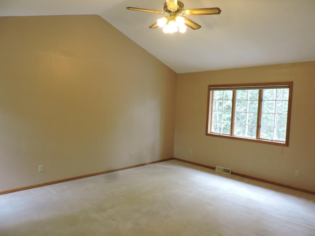 2nd floor master bedroom w/walk-in closet and private 3/4 bathroom.