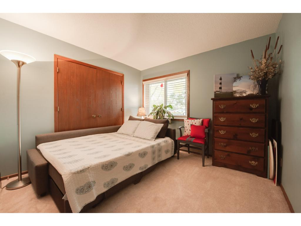 The second bedroom can alternatively be used as a den or playroom. Features of this space include a nice sized closet, window & French doors leading to the living room.