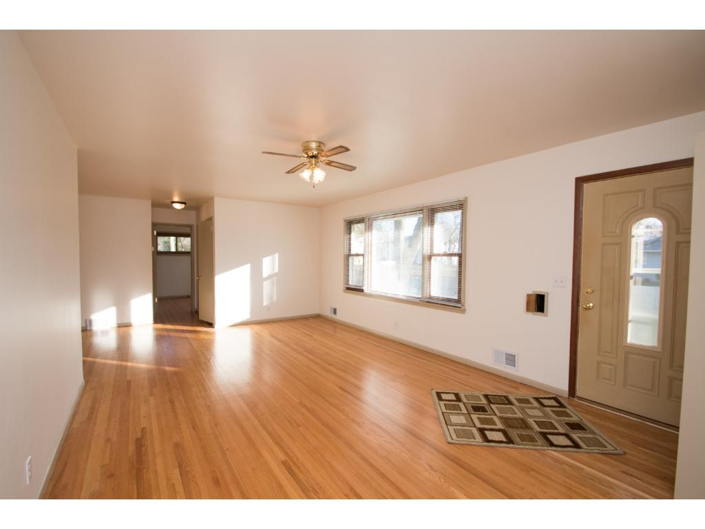 Living room  - Note beautiful hardwood floors and picture window.