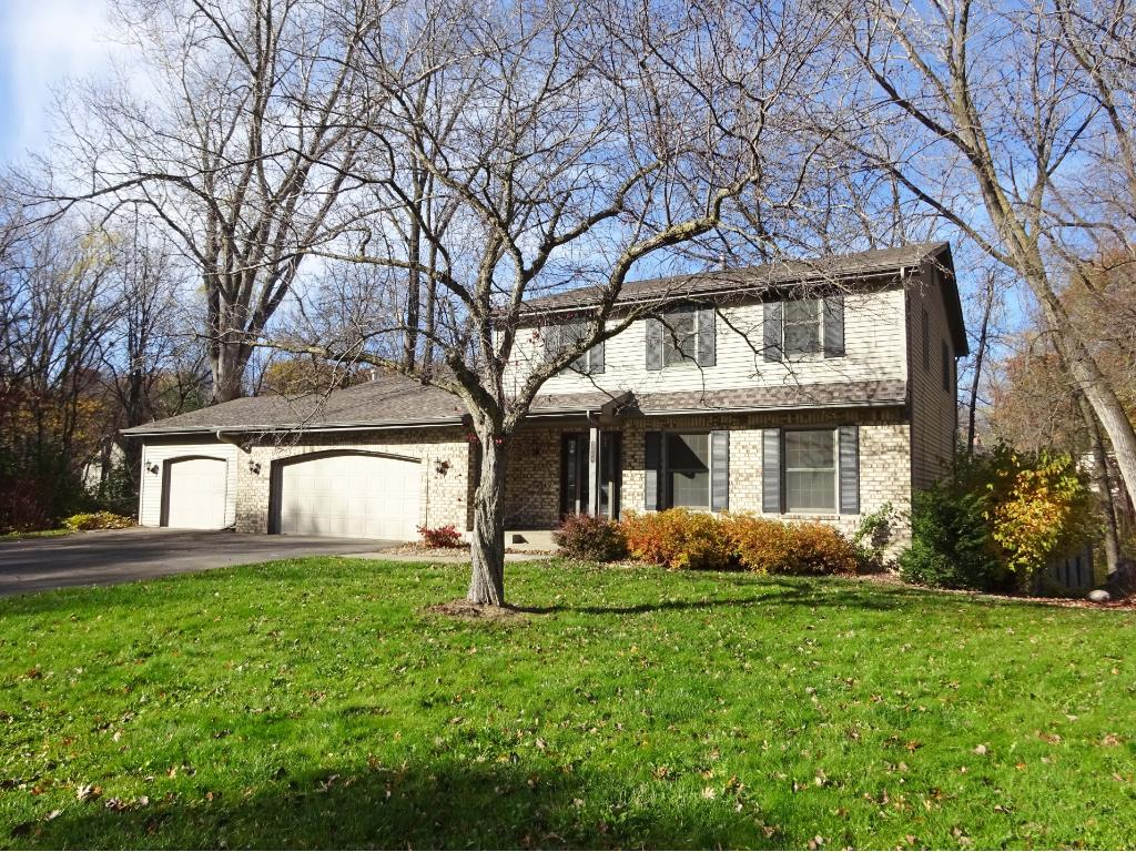 Beautiful 4 bedroom, 4 bath, 3 ar garage home on a heavily wooded cul de sac with lovely pond at the back.