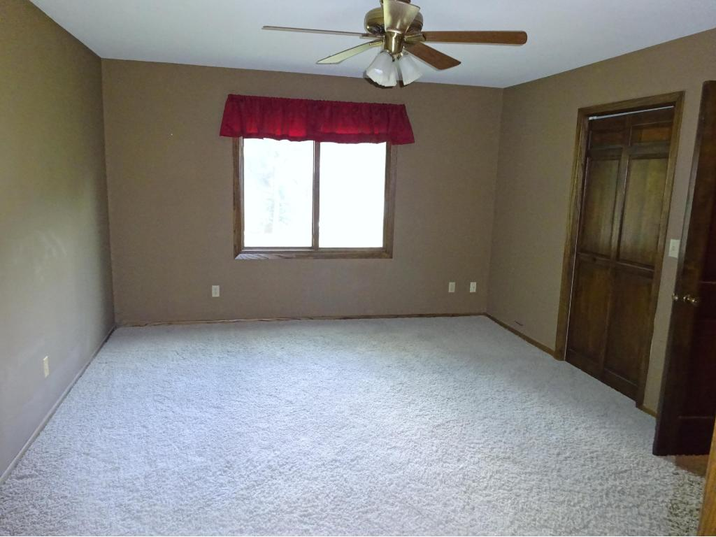 Master bath with newer flooring, cherry cabinets, quartz counters and separate shower and toilet.