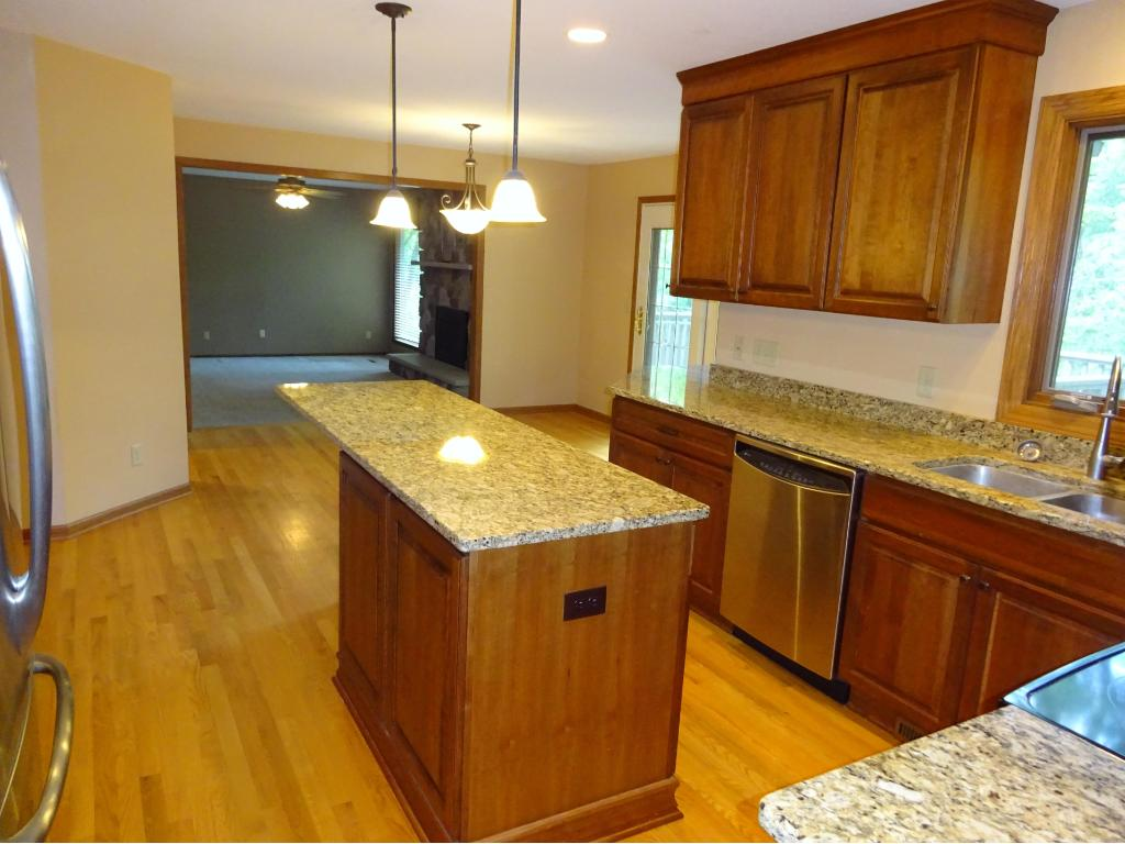 This amazing kitchen has newer cherry cabinets, newer stainless steel appliances, and granite countertops.
