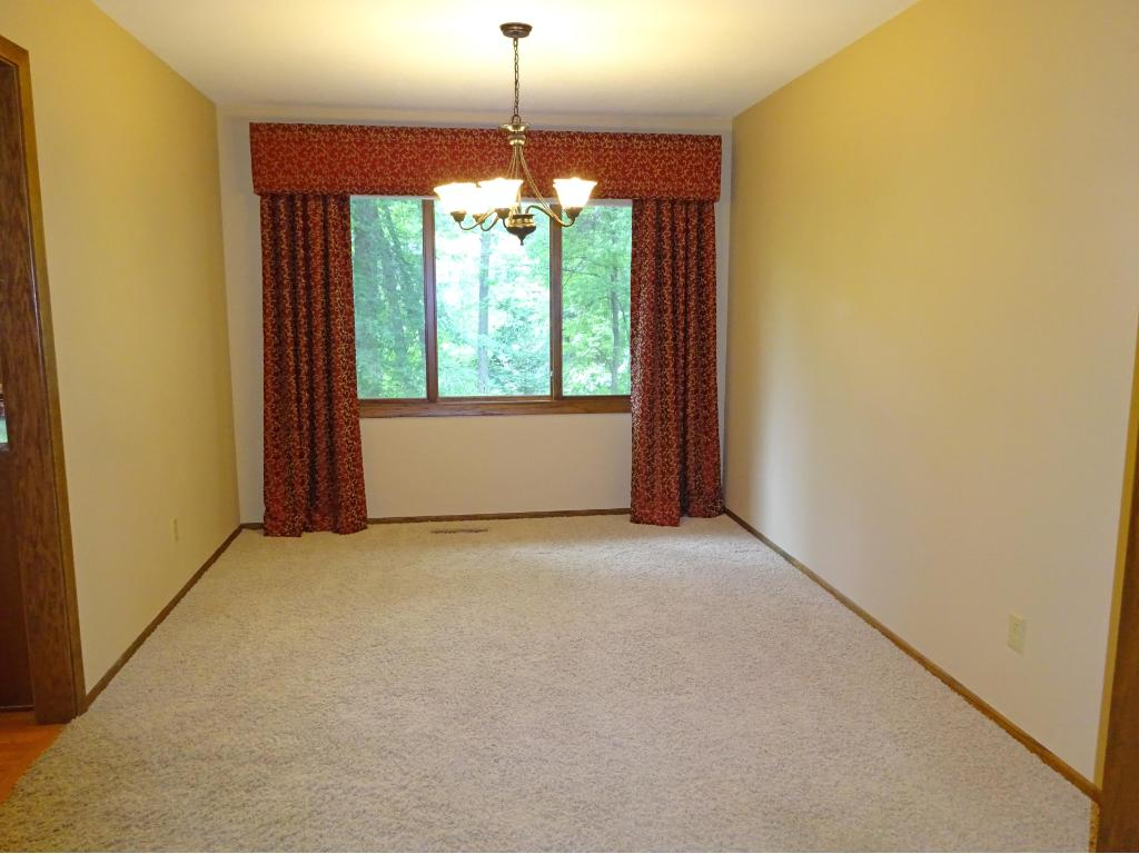 Large formal living room with newer neutral carpet.