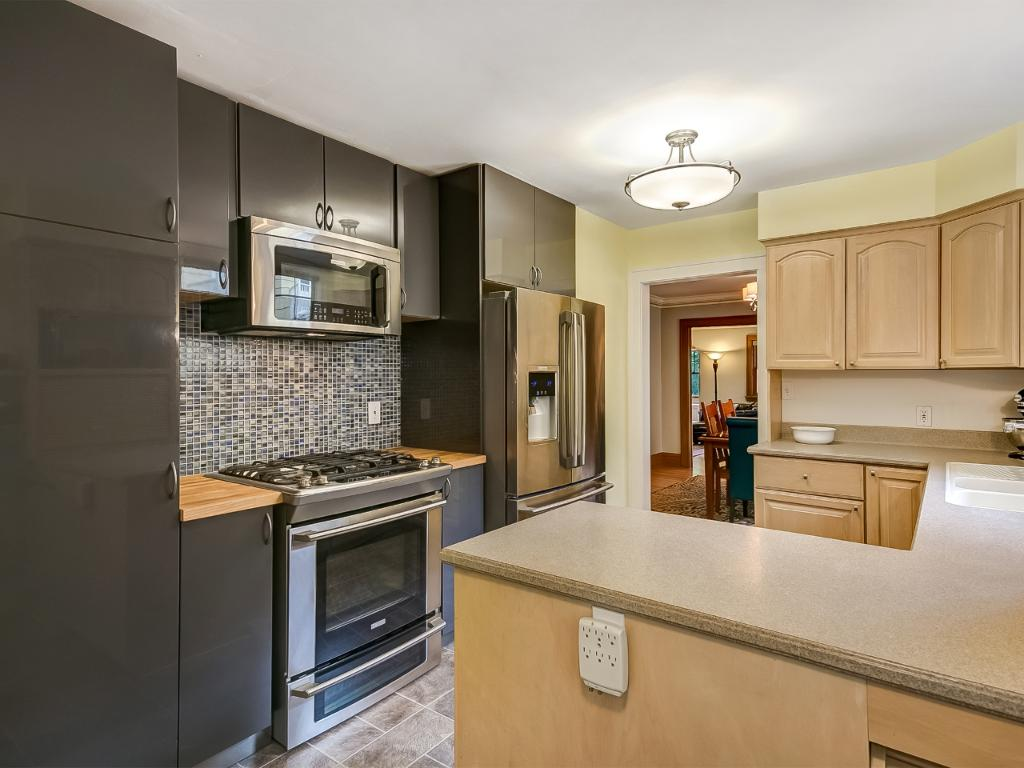 High-end stainless steel appliances and newer cabinets.