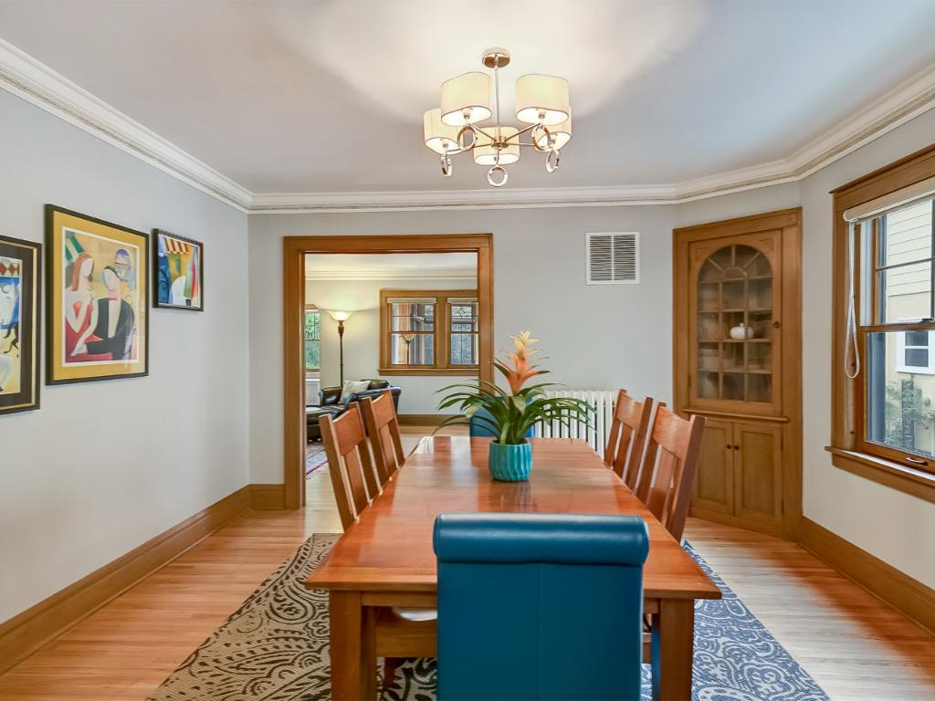 Freshly painted formal dining area great for entertaining guests.