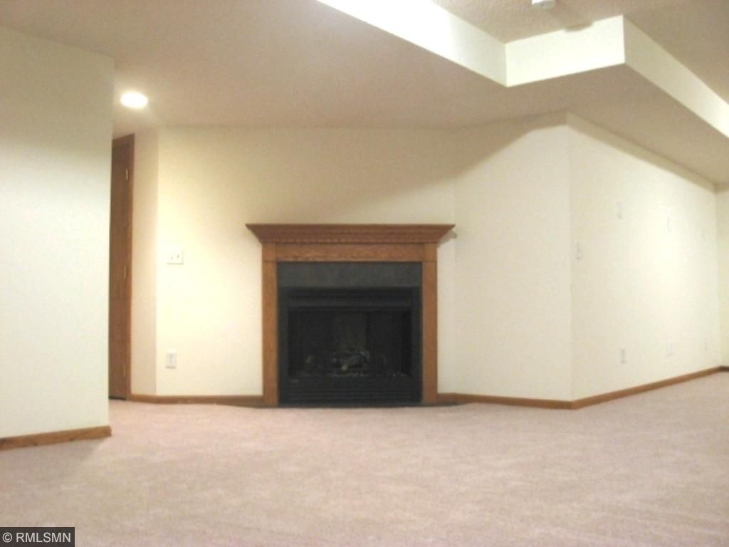 Basement with gas fireplace and new carpet and paint