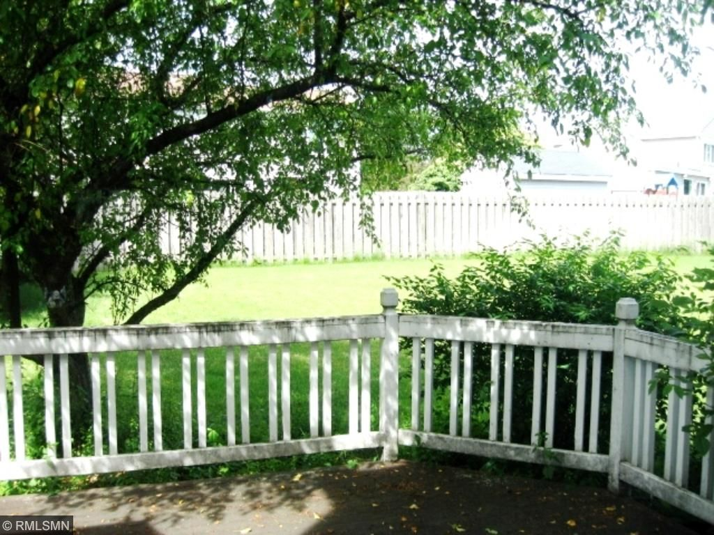 Back Yard with wood privacy fence and in ground sprinkler system
