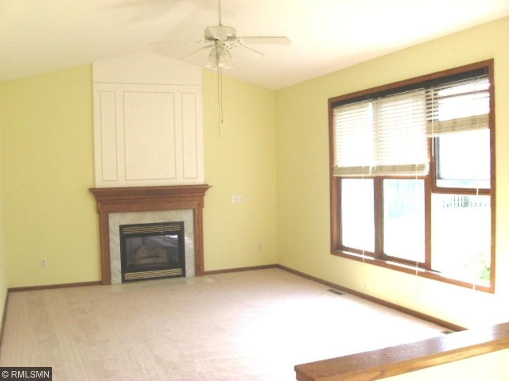 Family Room is vaulted with marble and wood surround gas fireplace