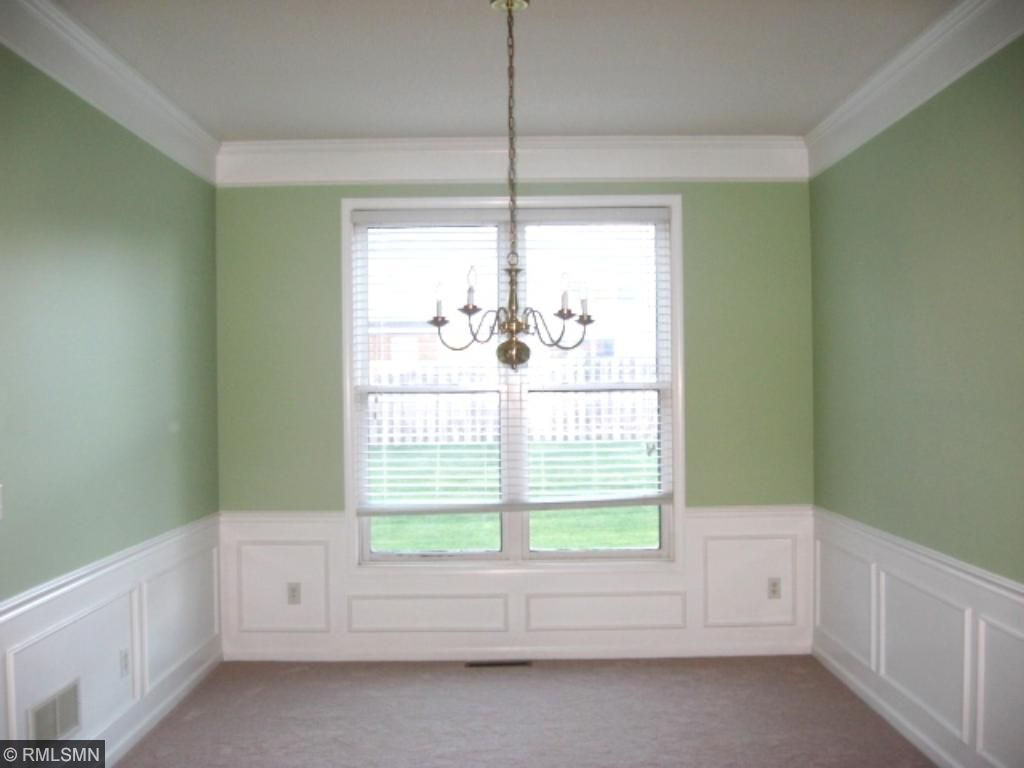Formal Dining Room with molded ceiling and library paneling