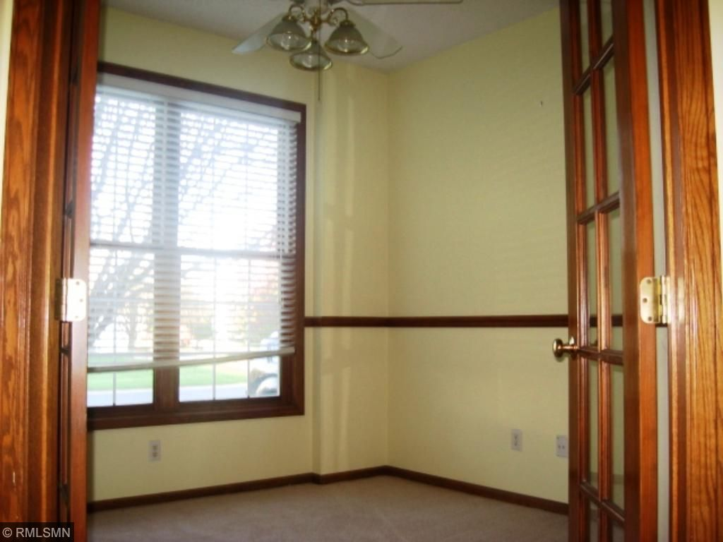Office with double doors and chair rail