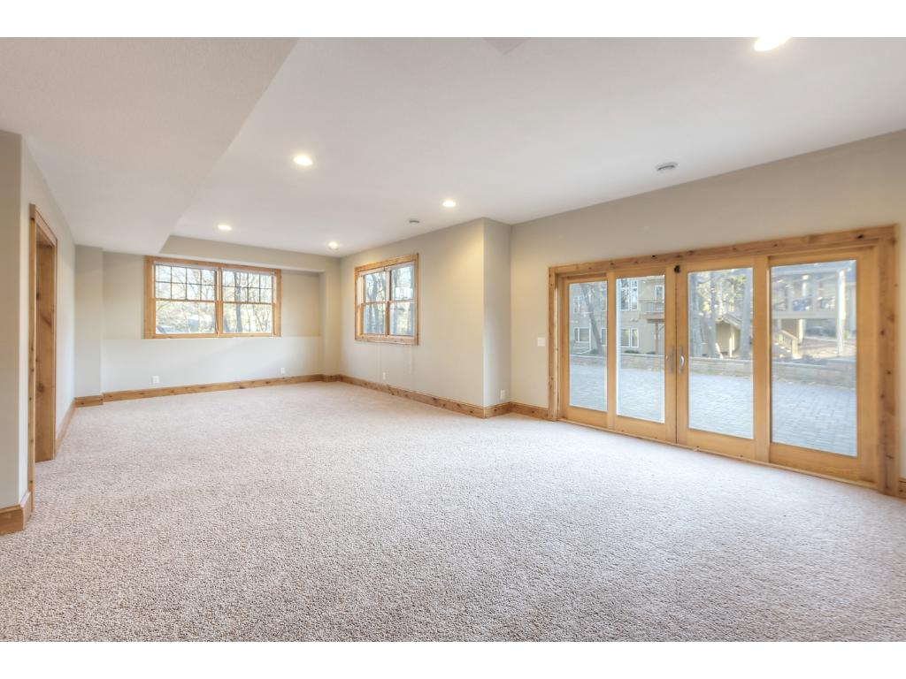 Large walkout level has 2 more bedrooms, big recreation space, rooms for theater and hobbies and more!