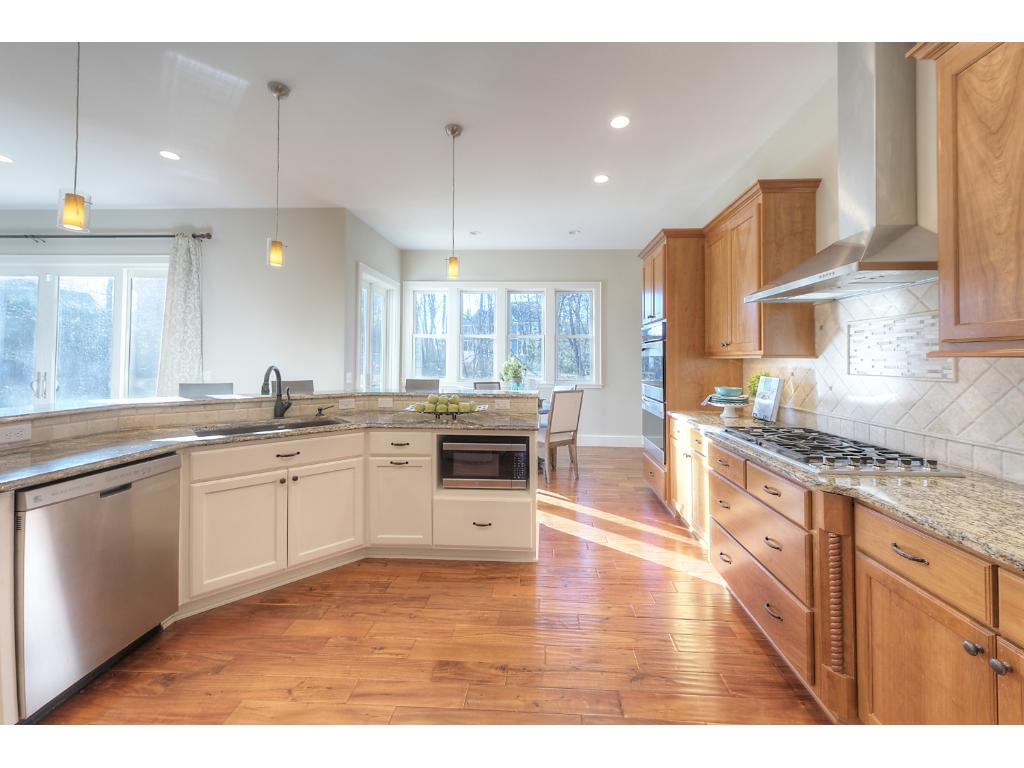 Spacious kitchen with lots of cabinets and granite counter space